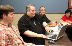 Fr. John makes the first online donation at the October Parish Pastoral Council meeting.