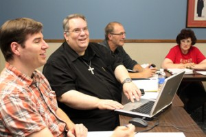 Fr. John Michniuk makes the first online donation to the parish at the October Parish Pastoral Council meeting.